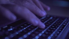 Close up of woman`s hands typing on laptop keyboard. In darkness stock video