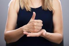 Woman Using Sign Language stock photo