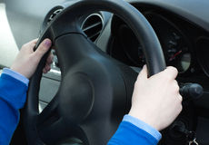 Close-up of woman's hands on the wheel Stock Image