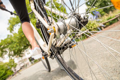 Close-up Of A Woman`s Leg Peddling Bicycle Royalty Free Stock Images