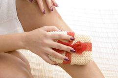 Close up of woman's leg with scrubber Royalty Free Stock Photos
