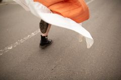 Close up on woman`s legs on the road. Woman running stock photography