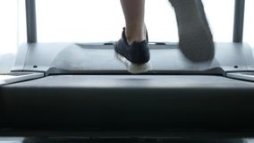 Close up woman`s legs on a treadmill in the gym stock footage