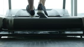 Close up woman`s legs on a treadmill in the gym stock video footage
