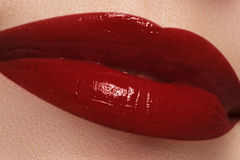 Close-up of woman's lips with fashion dark red lipstick makeup. Royalty Free Stock Photo