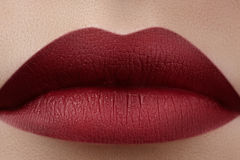 Close-up of woman's lips with fashion red make-up. Beautiful female mouth, full lips with perfect makeup. Classic visage Royalty Free Stock Image