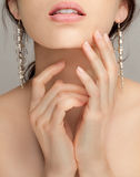 Close Up of Woman's Lips and Hands Stock Image