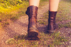 Close up on woman's muddy boots Royalty Free Stock Image