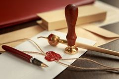 Close up on woman`s notary public hand ink stamping the document. Notary public concept royalty free stock image