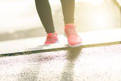 Close up of woman´s sports shoes. Young woman running up stairs. Healthy lifestyle. Fitness sport. Cardio training Stock Images