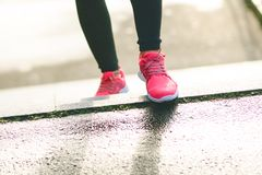 Close up of woman´s sports shoes. Young woman running up stairs. Healthy lifestyle. Fitness sport. Cardio training Royalty Free Stock Photography