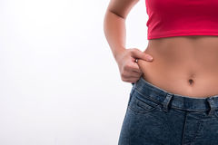 Close-up of woman's waist pinching excessive fat Stock Image