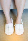 Close up of  woman`s white  slippers standing Royalty Free Stock Images