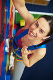 Close-up of woman in safety belt on the rock-climbing wall Stock Image