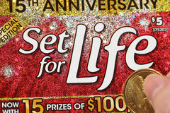 Close up woman scratching lottery ticket called set for life Stock Images