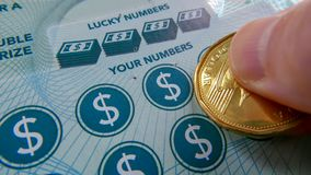 Close up of woman scratching lottery ticket. stock photos