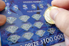Close up woman scratching lottery ticket Royalty Free Stock Photography