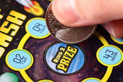 Close up woman scratching lottery tickets. stock photos