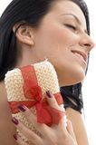 Close up of woman scrubbing her neck Stock Photo