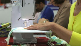 Close Up Of Woman Sewing Using Electric Machine stock footage