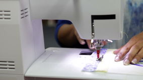 Close Up Of Woman Sewing Using Electric Machine stock video footage