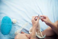 Close up woman sews a button Royalty Free Stock Photos