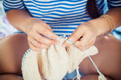 Close up woman sews a button Royalty Free Stock Images