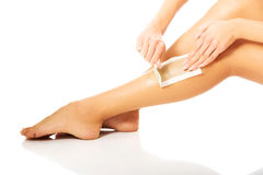 Close up on woman shaving her leg Royalty Free Stock Photo