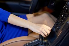 Close up of woman shifting gears on gearbox in car. Auto business, car sale, consumerism , transportation and people concept - close up of woman shifting gears Stock Photos