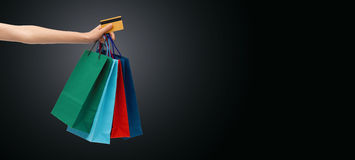 Close up of woman with shopping bags and bank card. People, sale, black friday and consumerism concept - close up of woman with shopping bags and bank or credit Stock Photo