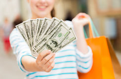 Close up of woman with shopping bags and money Royalty Free Stock Photo