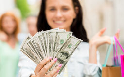 Close up of woman with shopping bags and money Royalty Free Stock Image