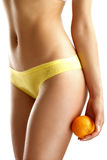 Close up of a woman showing hips with a fruit in her hand Royalty Free Stock Photography