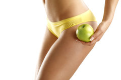 Close up of a woman showing hips with a fruit in her hand Royalty Free Stock Photo