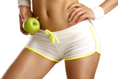 Close up of a woman showing hips with a fruit in her hand. On white Stock Image