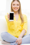 Close up of woman showing smartphone blank screen Stock Images