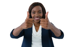 Close up of woman showing thumbs up gesture. Against white background Royalty Free Stock Photos