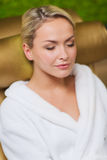 Close up of woman sitting in bath robe at spa Stock Photos