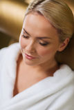 Close up of woman sitting in bath robe at spa Stock Images