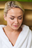 Close up of woman sitting in bath robe at spa Stock Image