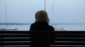 Close up of woman sitting on bench after jogging stock video