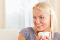 Close up of a woman sitting on a couch Stock Photos