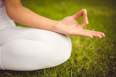 Close-up of woman sitting in lotus pose Stock Images