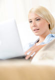 Close up of woman sitting with silver laptop Royalty Free Stock Image