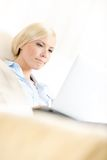 Close-up of woman sitting with silver pc stock images