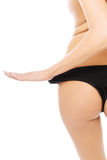 Close up on woman slim buttocks in black panties Royalty Free Stock Photos