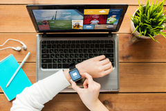 Close up of woman with smart watch and laptop Stock Photo