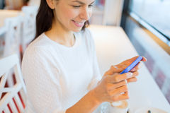 Close up of woman with smartphone at cafe Stock Image