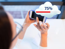 Close up of woman with smartphone cloud computing. People, technology and cloud computing concept - close up of woman hands with smartphone sharing or uploading Royalty Free Stock Photos