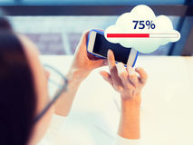 Close up of woman with smartphone cloud computing. People, technology and cloud computing concept - close up of woman hands with smartphone sharing or uploading Stock Photos